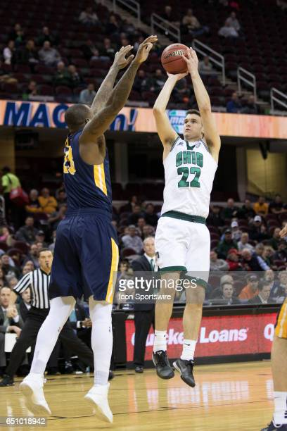 Ohio Bobcats G/F Gavin Block shoots as Toledo Rockets F Steve Taylor Jr defends during the second half of the MAC mens basketball tournament game...