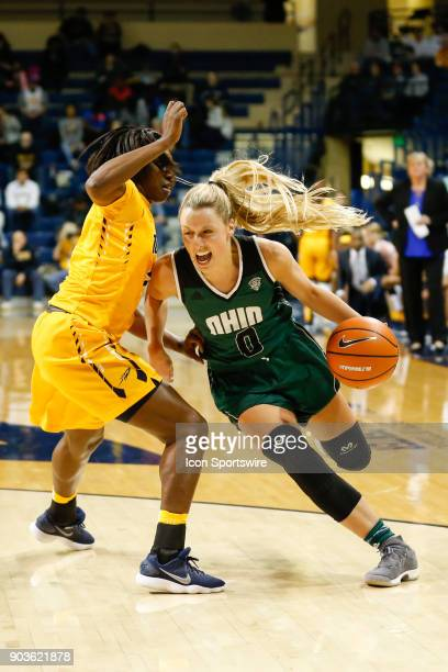 Ohio Bobcats guard Taylor Agler drive around Toledo Rockets guard Mikaela Boyd during the second half of a regular season MidAmerican Conference game...