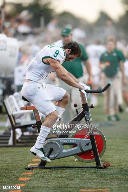 Ohio Bobcats wide receiver Andrew Meyer warms up on an exercise bike in the second half of a game between the Ohio Bobcats and the Bowling Green...