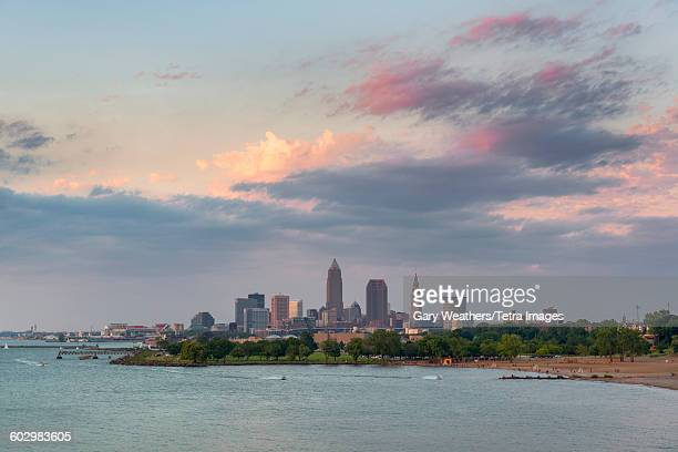 usa, ohio, cleveland, beach with skyline in background - ohio stock pictures, royalty-free photos & images