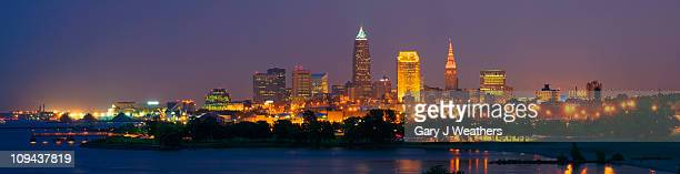 usa, ohio, cleveland, city skyline illuminated at dusk - cleveland ohio stock pictures, royalty-free photos & images