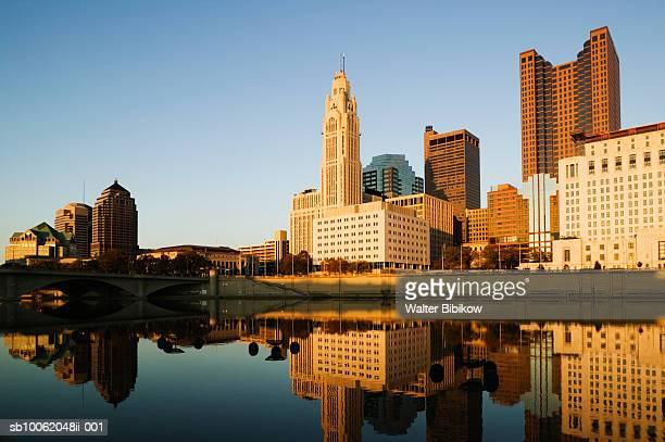 usa, ohio, columbus, city skyline along scioto river - columbus ohio stock pictures, royalty-free photos & images