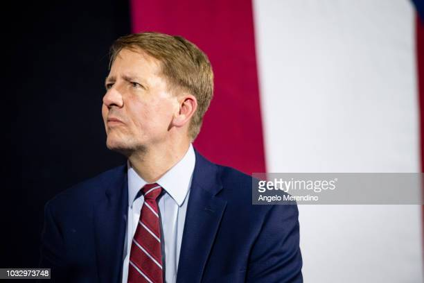 Ohio Democratic Gubernatorial candidate Richard Cordray listens while former president Barack Obama speaks during a campaign rally at CMSD East...