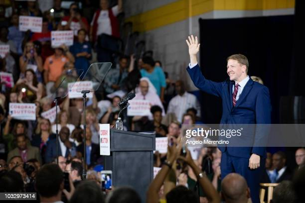 Ohio Democratic Gubernatorial candidate Richard Cordray waves to his supporters during a campaign rally at CMSD East Professional Center Gymnasium on...