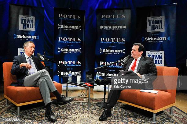 Ohio Governor and republican presidential candidate John Kasich speaks with host Tim Farley during SiriusXM POTUS's Town Hall Series on December 3...