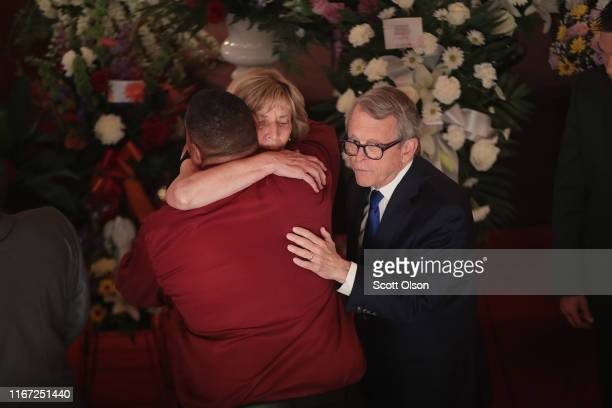Ohio Governor Mike DeWine and his wife Frances Struewing greet family members at the funeral of Derrick Fudge at St John Missionary Baptist Church on...