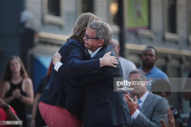 Ohio Governor Mike DeWine embraces Dayton Mayor Nan Whaley during a memorial service in the Oregon District held to recognize the victims of an...