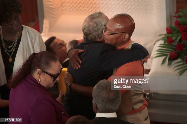 Ohio Governor Mike DeWine hugs Roderick Fudge during the visitation and funeral service for his brother Derrick Fudge at St John Missionary Baptist...