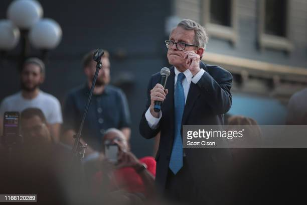 Ohio Governor Mike DeWine speaks to mourners at a memorial service in the Oregon District held to recognize the victims of an earlymorning mass...