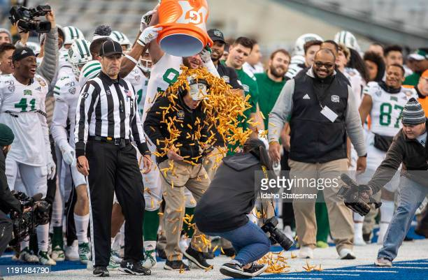 Ohio head coach Frank Solich is showered with french fries near the end of a 3021 win against Nevada in the Famous Idaho Potato Bowl on Friday Jan 3...
