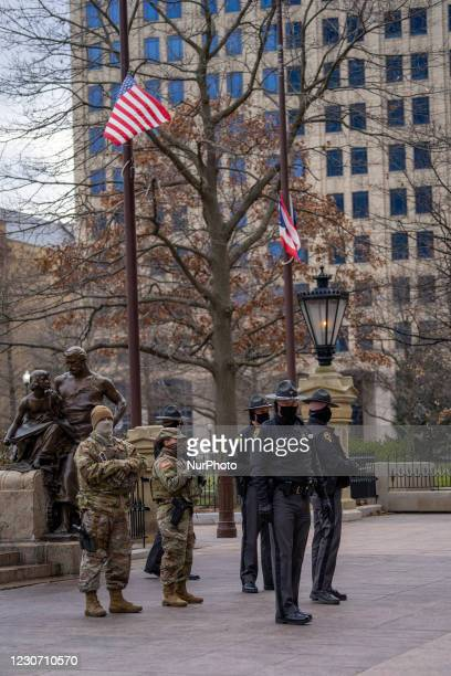 Ohio National Guard and State Patrol officers stand guard as members of Antifa march from City Hall to the Ohio Statehouse after President Joe Biden...