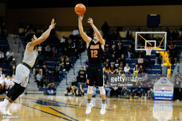 Ohio Northern Polar Bears guard Nate Burger shoots a jump shot during a regular season game between the Ohio Northern Polar Bears and the Toledo...