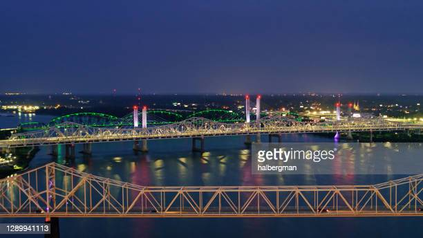 ohio river bridges between louisville and indiana lit up at night - louisville kentucky stock pictures, royalty-free photos & images