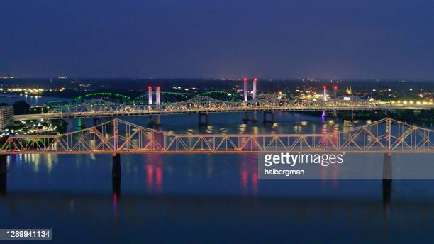 ohio river bridges to louisville lit up at night - louisville kentucky stock pictures, royalty-free photos & images