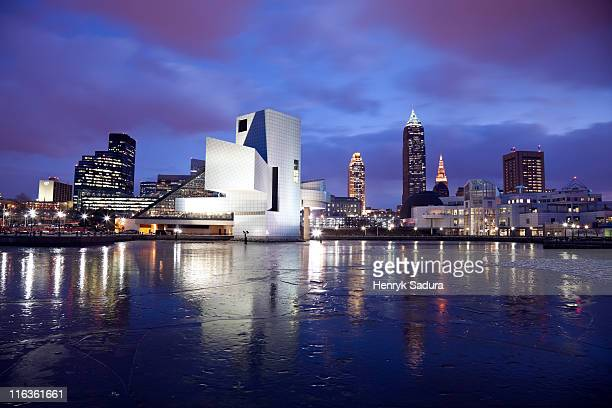 usa, ohio, rock and roll hall of fame and museum across frozen lake at dusk - cleveland ohio stock photos and pictures