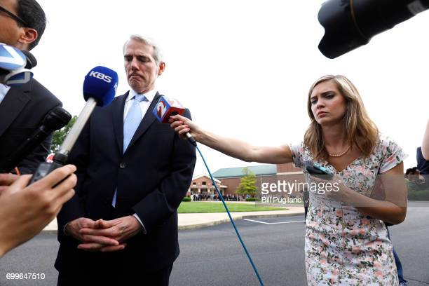 Ohio Sen Rob Portman speaks with the news media as he arrives at Wyoming High School for the funeral of Otto Warmbier June 22 2017 in Wyoming Ohio...
