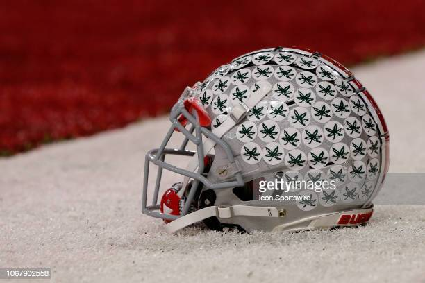 Ohio State Buckeye helmet sits on the turf prior to the Big Ten Conference Championship game between the Northwestern Wildcats and the Ohio State...