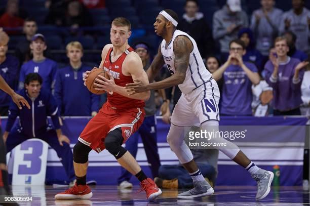 Ohio State Buckeyes center Micah Potter battles with Northwestern Wildcats center Dererk Pardon during the BIG Ten college basketball game between...