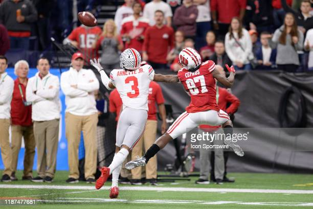 Ohio State Buckeyes cornerback Damon Arnette and Wisconsin Badgers wide receiver Quintez Cephus battle for a catch during the Big Ten Conference...