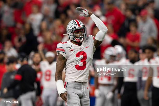 Ohio State Buckeyes cornerback Damon Arnette signals for more crowd noise during the Big 10 Championship game between the Wisconsin Badgers and Ohio...