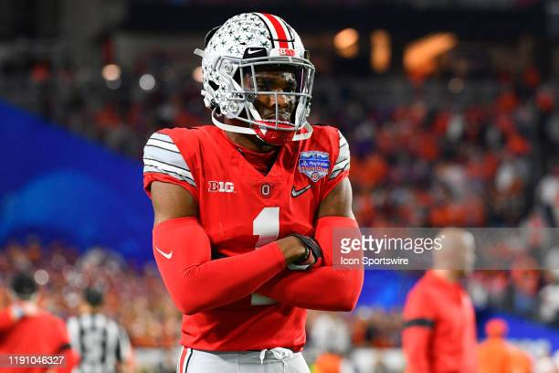 Ohio State Buckeyes cornerback Jeff Okudah looks on before the 2019 PlayStation Fiesta Bowl college football playoff semifinal game between the Ohio...