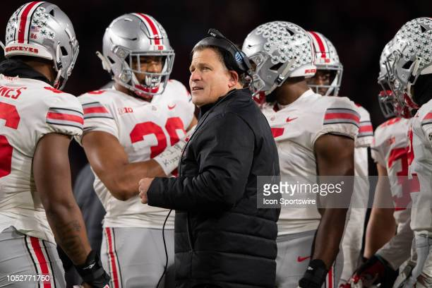 Ohio State Buckeyes defensive coordinator Greg Schiano looks at a replay during the college football game between the Purdue Boilermakers and Ohio...