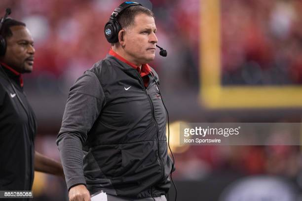 Ohio State Buckeyes defensive coordinator Greg Schiano watches from the sidelines during the Big 10 Championship game between the Wisconsin Badgers...
