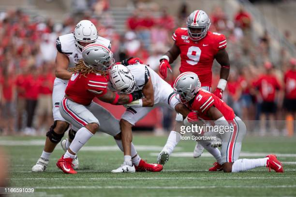 Ohio State Buckeyes defensive end Chase Young and Ohio State Buckeyes cornerback Damon Arnette tackle Cincinnati Bearcats wide receiver Trent Cloud...