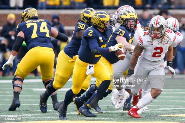 Ohio State Buckeyes defensive end Chase Young chases after Michigan Wolverines quarterback Shea Patterson during a regular season Big 10 Conference...
