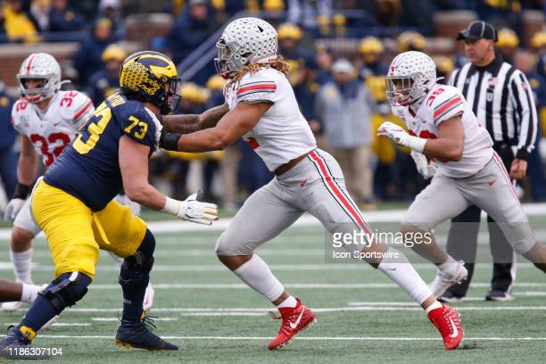 Ohio State Buckeyes defensive end Chase Young rushes against Michigan Wolverines offensive lineman Jalen Mayfield during a regular season Big 10...