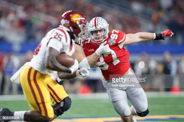 Ohio State Buckeyes defensive end Nick Bosa works around a block and closes in on USC Trojans running back Ronald Jones II during the Cotton Bowl...
