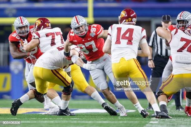 Ohio State Buckeyes defensive end Nick Bosa works past the block of USC Trojans tackle Toa Lobendahn on his way to the quarterback during the Cotton...