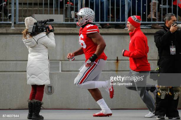 Ohio State Buckeyes defensive lineman Dre'Mont Jones runs to the locker room after being ejected from the game for targeting during game action...
