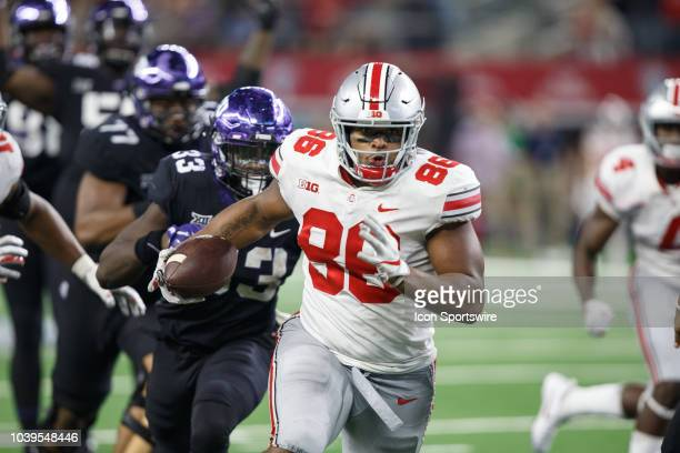 Ohio State Buckeyes defensive tackle Dre'Mont Jones runs up field for a touchdown after intercepting a pass from TCU Horned Frogs quarterback Shawn...
