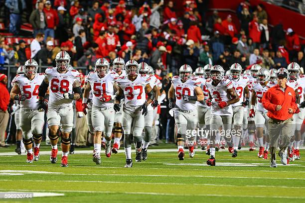 Ohio State Buckeyes enter the field prior to the game between the Rutgers Scarlet Knights and the Ohio State Buckeyes played at High Point Solutions...