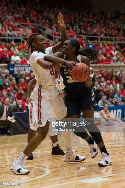Ohio State Buckeyes forward Alexa Hart and George Washington Colonials forward Neila Luma tangle during the first round game of the Div I Women's...