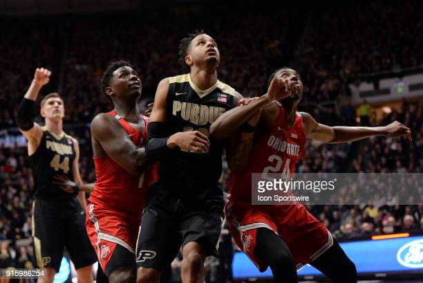 Ohio State Buckeyes forward Jae'Sean Tate and Ohio State Buckeyes forward Andre Wesson work to box out Purdue Boilermakers forward Vincent Edwards as...