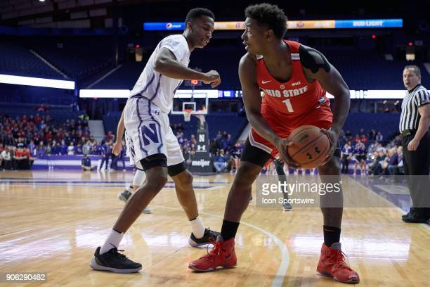 Ohio State Buckeyes forward Jae'Sean Tate battles with Northwestern Wildcats forward Vic Law during the BIG Ten college basketball game between the...