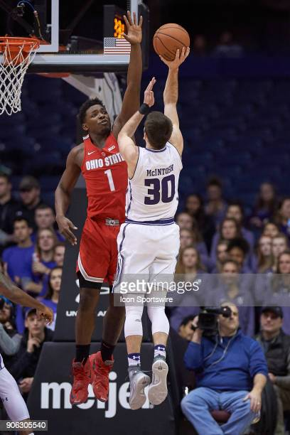 Ohio State Buckeyes forward Jae'Sean Tate battles with Northwestern Wildcats guard Bryant McIntosh during the BIG Ten college basketball game between...