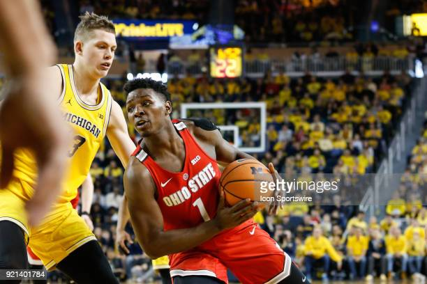 Ohio State Buckeyes forward Jae'Sean Tate drives to the basket against Michigan Wolverines forward Moritz Wagner during a regular season Big 10...