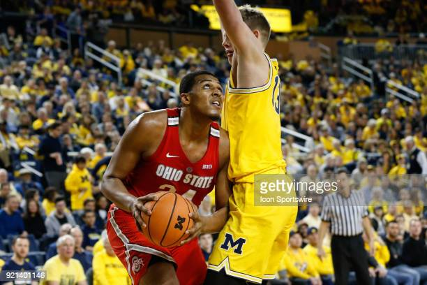 Ohio State Buckeyes forward Kaleb Wesson looks to shoot against Michigan Wolverines forward Moritz Wagner during a regular season Big 10 Conference...