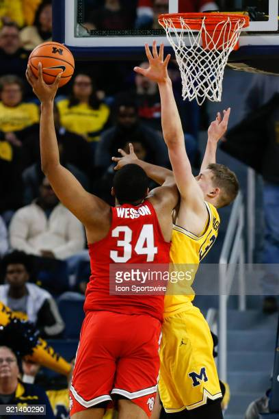 Ohio State Buckeyes forward Kaleb Wesson shoots over Michigan Wolverines forward Moritz Wagner during a regular season Big 10 Conference basketball...