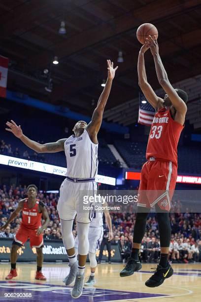 Ohio State Buckeyes forward Keita BatesDiop shoots the basketball past Northwestern Wildcats center Dererk Pardon during the BIG Ten college...