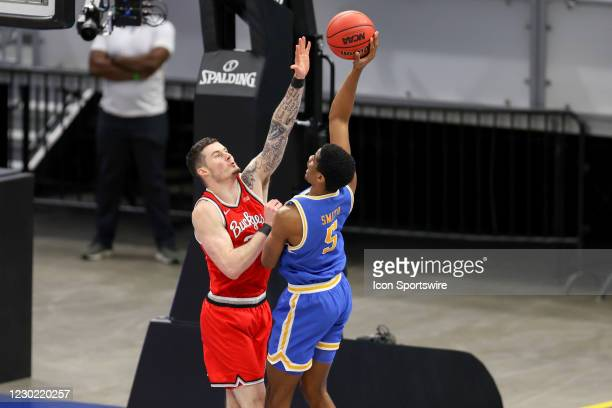 Ohio State Buckeyes forward Kyle Young defends the shot of UCLA Bruins guard Chris Smith during the second half of the mens college basketball game...