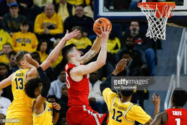 Ohio State Buckeyes forward Kyle Young goes in for a layup against Michigan Wolverines forward Moritz Wagner Michigan Wolverines guard Jordan Poole...