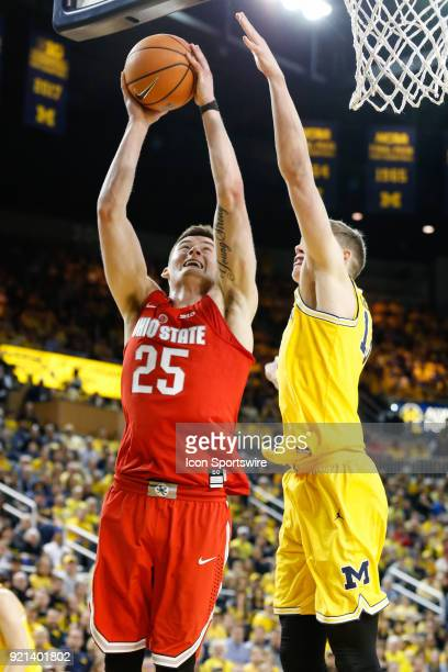 Ohio State Buckeyes forward Kyle Young goes in for a layup against Michigan Wolverines forward Moritz Wagner during a regular season Big 10...
