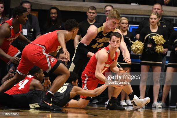 Ohio State Buckeyes guard Andrew Dakich is fouled by Purdue Boilermakers center Isaac Haas while both players battle for a loose ball during the Big...