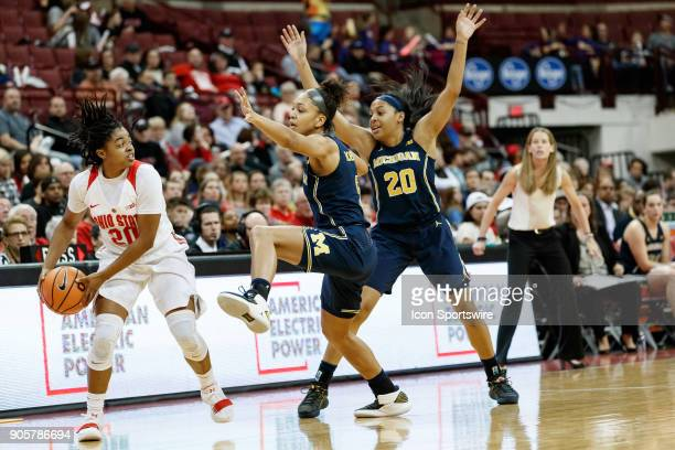 Ohio State Buckeyes guard Asia Doss looks to pass the ball as Michigan Wolverines forward Kayla Robbins and Michigan Wolverines guard Deja Church...