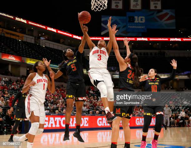 Ohio State Buckeyes guard Kelsey Mitchell is fouled by Maryland Terrapins guard Kaila Charles going to the basket during the Big Ten Women's...