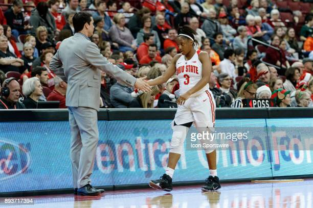 Ohio State Buckeyes guard Kelsey Mitchell returns to the bench and high fives Ohio State Buckeyes head coach Kevin McGuff during a game between the...